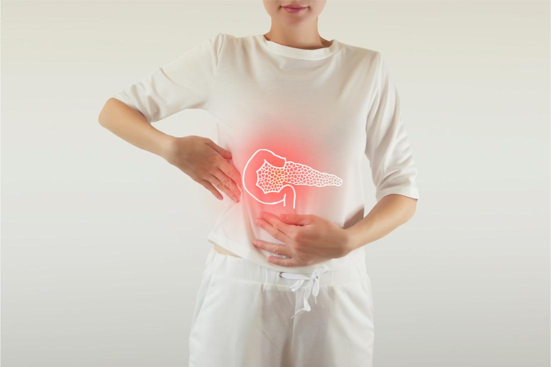 postava ženy s červenou ikonou pankreasu v oblasti brucha